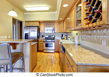 Wood golden kitchen in luxury apartment.