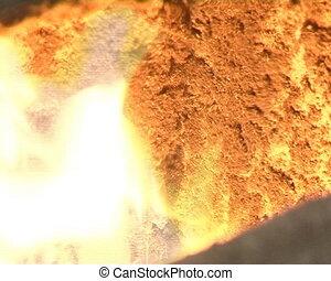 wood granules boiler. boiler door slightly open and fire...