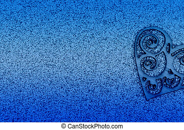 Wood heart with blue glitter paper background