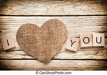 Wood heart. - Wood heart on old wooden background - Stock...