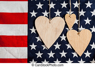 Wood hearts on american flag background
