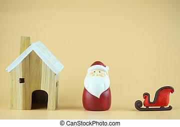 Wood home, cute Santa claus and sleigh.