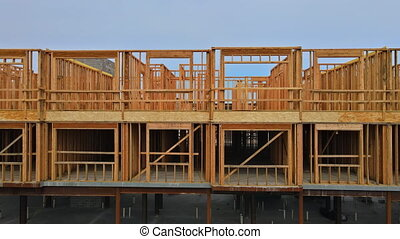 Wood home framing at construction site with wooden truss framework
