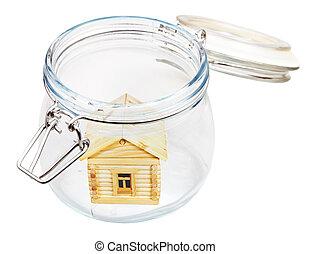 wood house in glass jar