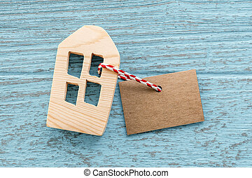 Wood house with blank paper tag