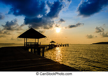 Wood jetty on the Beach and tropical sea