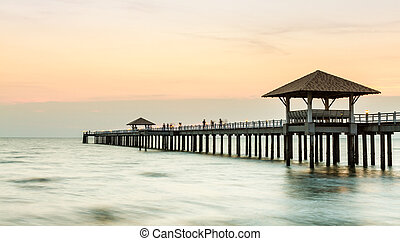Wood jetty on the Beach and tropical sea,East of Thailand.