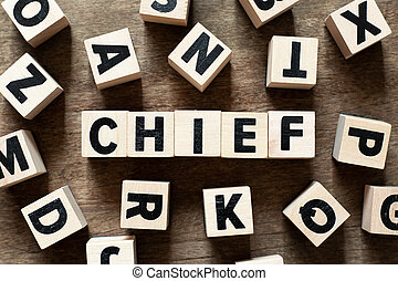 Wood letter block in word chief on wood background with another alphabet