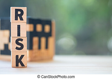 Wood letter block in word risk