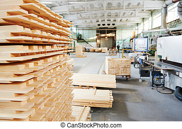 wood lumber materials at plant - Stacked wood pine timber ...
