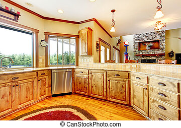 Wood luxury home kitchen interior. New Farm American home.