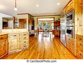 Wood luxury home kitchen interior. New Farm American home.