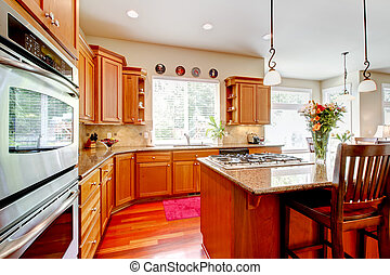Wood luxury large kitchen with red and granite.