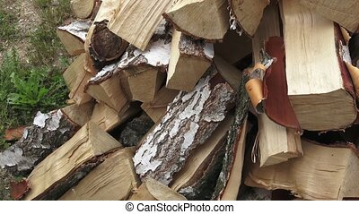 Wood made from birch (cut version). Pile of chopped fire wood prepared for winter. Birch firewood.