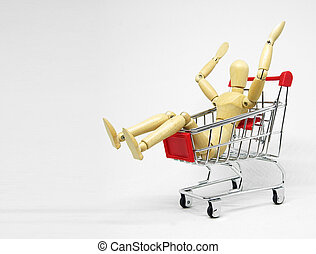 Wood manikin shopping with cart.