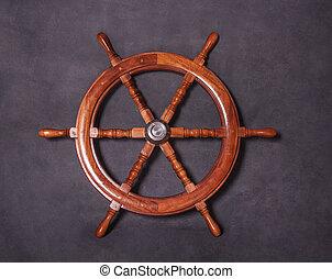 Wood marine steering wheel on a dark background