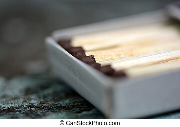 wood match on paper box close up