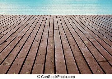 Wood on beach at sea.