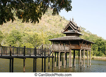 wood pavilion on the pond