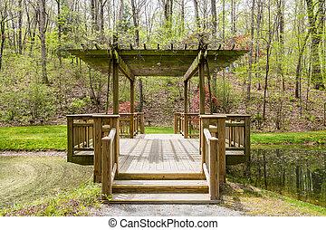Wood Pavilion Over Lake