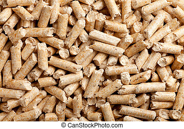 wood pellets background - some wood pellets forming a ...