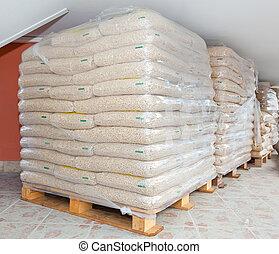 Wood pellets - Pallets of wood pellets in plastic bags