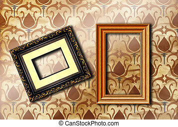 Wood picture frames hanging on retro wallpaper
