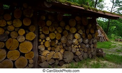 Wood pile in village - Stack of wood in village in summer