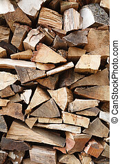 Wood pile - Closeup of sawn oak firewood stacked in a...
