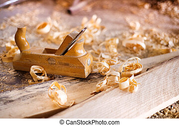 Wood planer and shavings - Wood planer, wooden planks and...