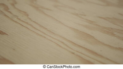 Wood plank in woodshop - Close up of a piece of freshly cut ...