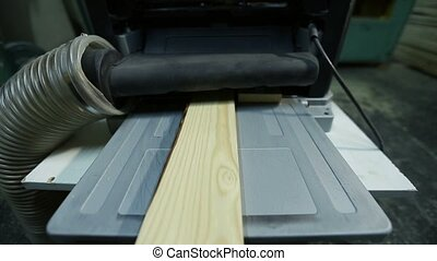 Wood planks after planing with electric planer