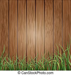 Background of wooden planks and green grass.