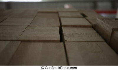 Wood planks in woodshop - Close up of pieces of freshly cut ...