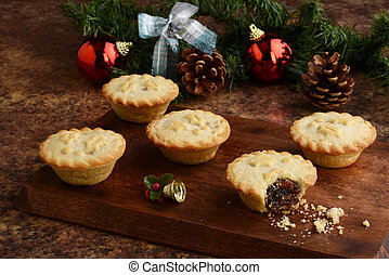 wood platter of christmas mincemeat pies