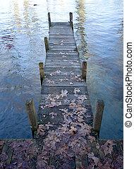 Wood pontoon, water, on Annecy lake, France.