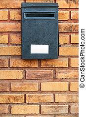 Wood post box on brick wall