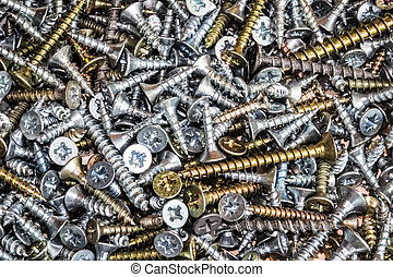 Wood screws cross shaped head on a table close up