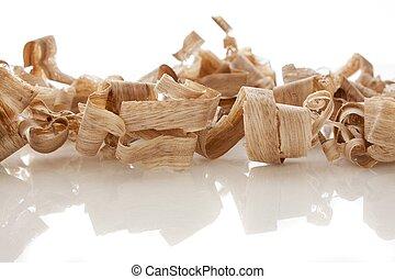 wood shavings over white background