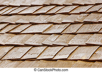 Wood shingle tiles on a roof. Finland traditional construction