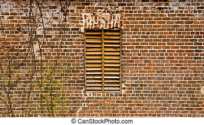 Wood Shutter on Old Brick