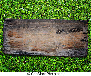 Wood Sign on Grass Background