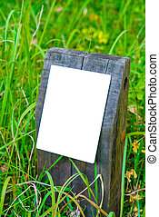 Wood sign on grass