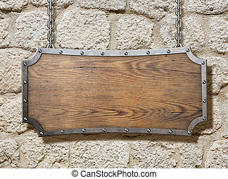 wood sign with metal frame on old stone wall - wood sign...