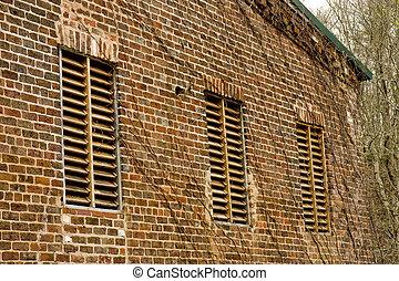 Wood Slat Windows in Old Brick Mill