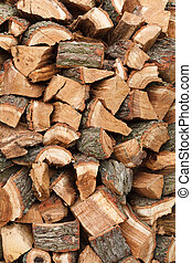Wood stack - Detail of a stack of oak firewood chopped and...