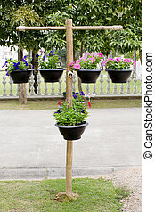Wood stand with pots of flowers
