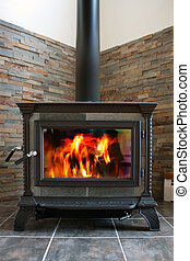 Wood Stove - A new cast iron wood stove burning hot with...