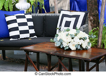 Wood table decorated with white roses