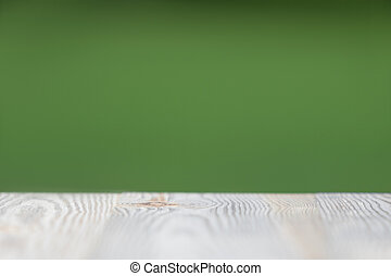 Wood table on blur abstract nature green background with copyspace